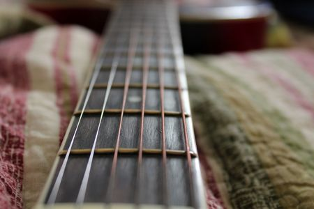 neck of acoustic guitar with steel strings