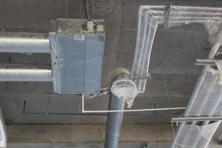 fan coil with connected air ducts and water pipes