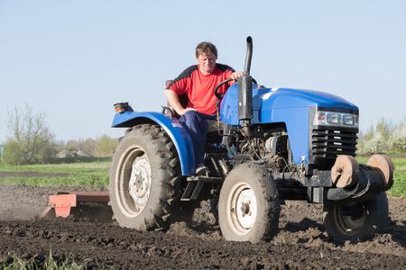 Tractor with attached cutter