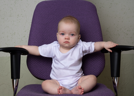 tired child sitting on the office chair Stock Photo