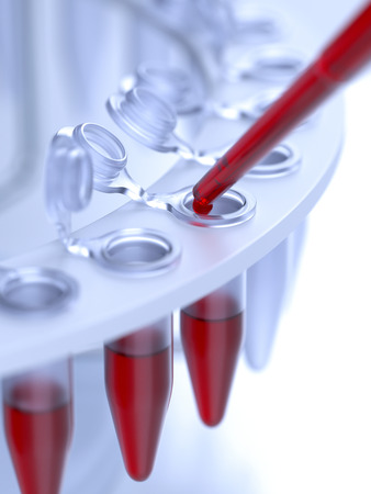 Dropping blood sample in test-tube close-up