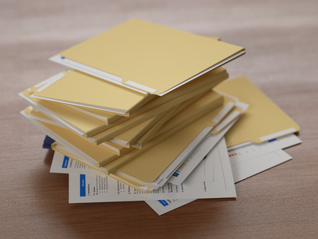Stack of business reports on wooden table photo