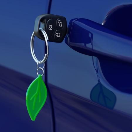 Car key with green leaf keychain photo