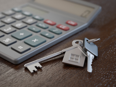 Mortgage application concept with house keys and calculator