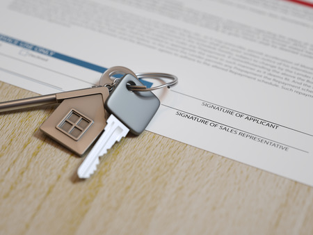Mortgage application concept with house keys and calculator photo