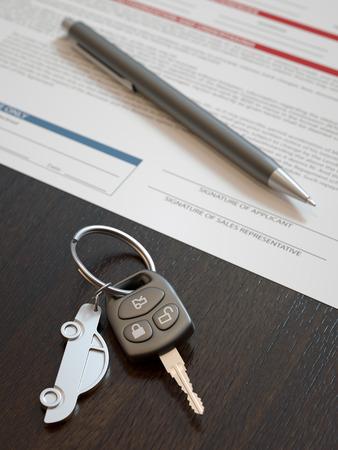 Car loan application concept with car keys photo
