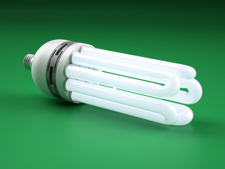 powerful creativity: Big powerful compact fluorescent lightbulb on green background