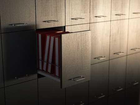 File cabinet with half-open drawer photo