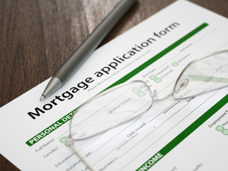 mortgage application: Mortgage application concept with house keys and calculator
