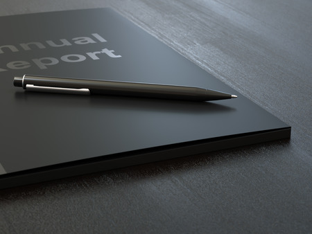 Black annual report folder and pen on dark wood table close-up Stock fotó