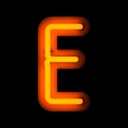 Neon Letter E from neon alphabet collection isolated on black Фото со стока