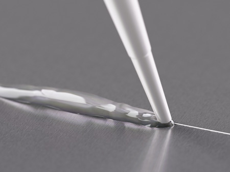 silicone: Pouring Silicone Sealant Close-up Shot Stock Photo