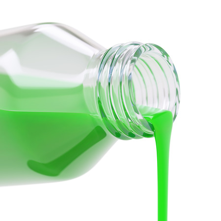 colorant: Pouring green paint or colorant close-up