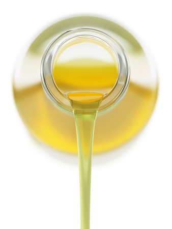 vegetable oil: Pouring vegetable oil from a glass bottle Stock Photo
