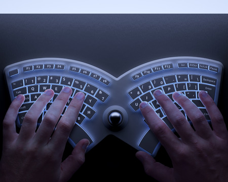 Human hands with conceptual ergonomic keyboard 写真素材