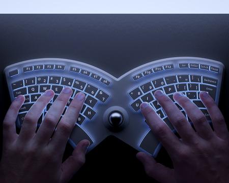 ergonomic: Human hands with conceptual ergonomic keyboard Stock Photo