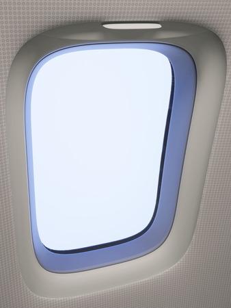 ventana abierta interior: Mirando a través de una ventana del avión de cerca