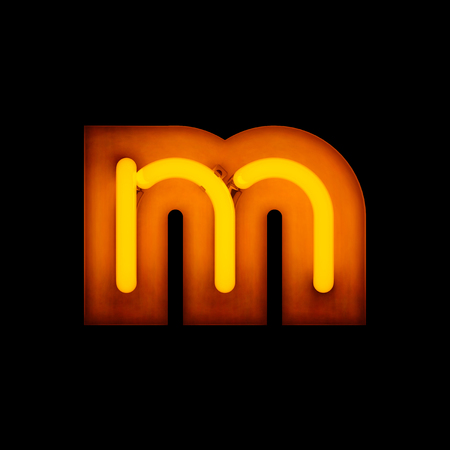 Neon Letter m lower case neon alphabet collection isolated on black Stock Photo