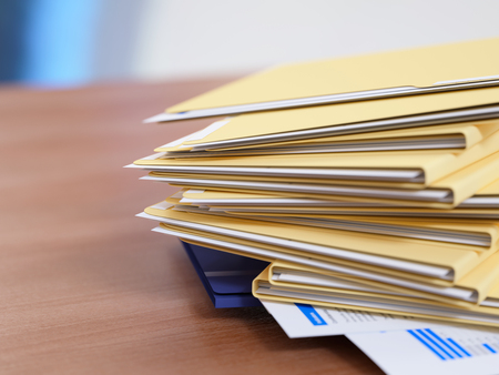 file folder: Stack of papers on a table close-up