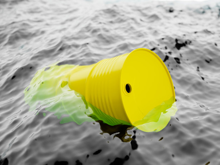 ocean waves: Yellow barrel floating on the waves, ocean pollution concept Stock Photo