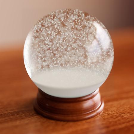 Empty snow globe on wooden table Archivio Fotografico