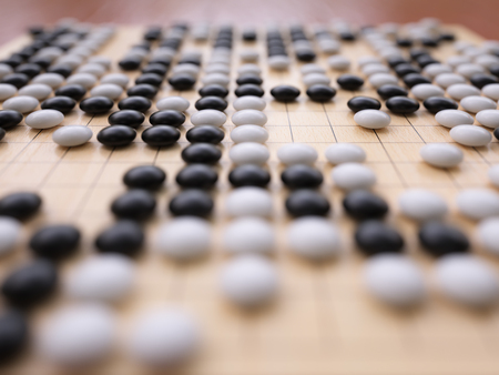 Traditional asian game Go playing field close-up Stock Photo
