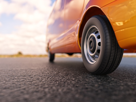 foreground: Orange van wheel close-up 3d illustration