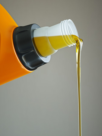 lubricant: Pouring engine oil close-up isolated on grey background 3d illustration Stock Photo