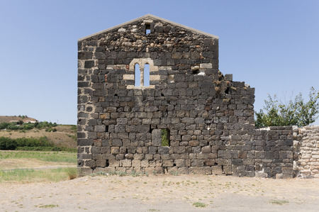 double lancet window in a stone wall. photo