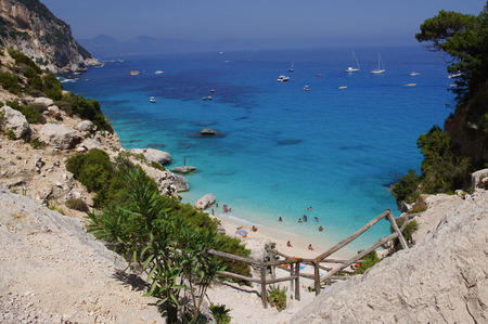 Beach Cala Goloritze in Sardinia. This beautiful bay is located on the eastern coast of Sardinia. It is accessible by boat or on foot via a path through the rugged mountains. photo