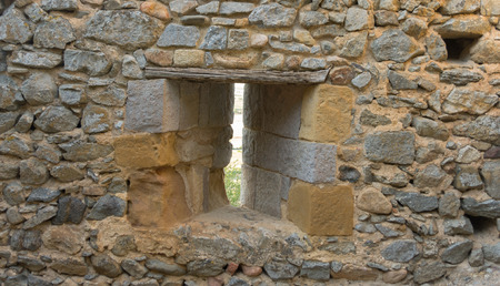 loophole: loophole into the stone walls of a medieval castle