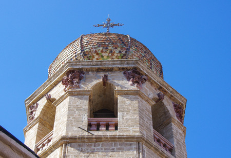 Bell tower and dome of colored cathedral Oristano, Sardinia