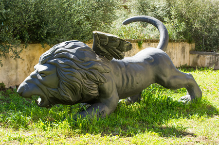 parable: Bronze sculpture, Winged Lion on green grass