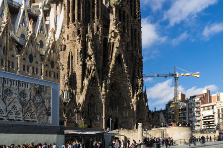gothic build: Barcellona, Spain, March 3, 2015: Tourists visit the Sagrada Familia by Antoni Gaudi