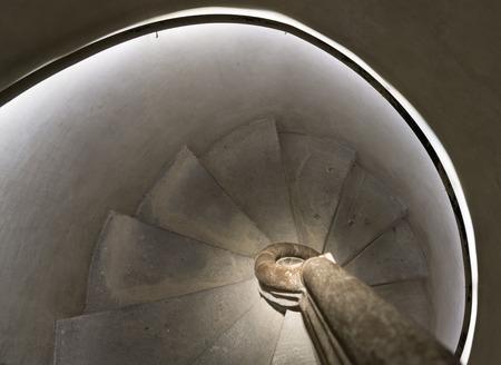 stone spiral staircase inside a Gothic church