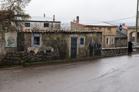 fart: Old fart with murals on a street in Fonni, Sardinia