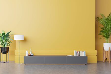 Cabinet For TV or place object in modern living room with lamp,table,flower and plant on yellow wall background,3d rendering