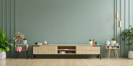 Cabinet TV in empty interior room ,dark wall with wood shelf,lamp ,plants and table wood ,3d rendering