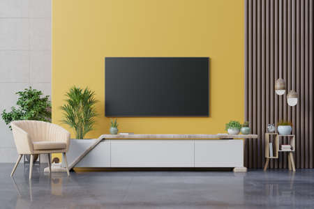 Living room led tv on yellow wall with armchair and cabinet tv on yellow wall background,3d rendering
