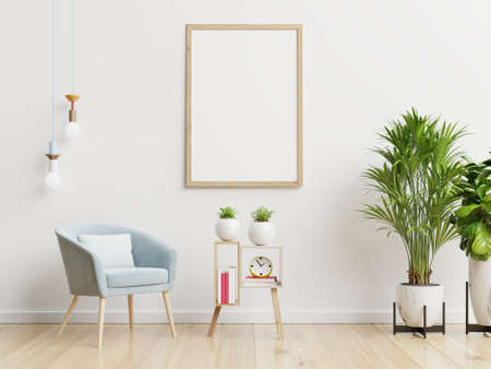 Poster mockup with vertical frames on empty white wall in living room interior with blue velvet armchair.3D rendering 版權商用圖片