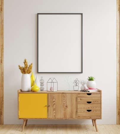 Mock up poster frame on cabinet in interior,white wall.3d rendering Reklamní fotografie