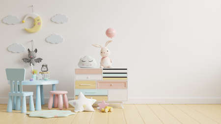 Mock up wall in the children's room with kid table set in light white color wall background,3d rendering