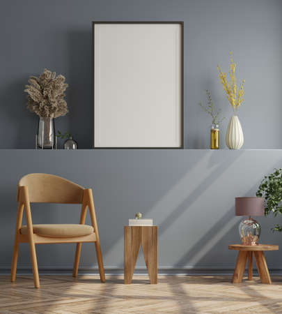 Poster mockup with vertical frames on empty dark wall in living room interior with velvet armchair.3D rendering