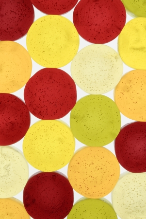 jellybean: Round colorful marmalade pieces lying in the background