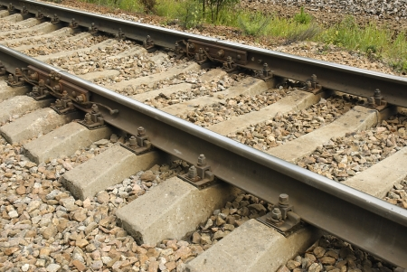 Railroad tracks laid on sleepers metal bolts Stock Photo - 21651814