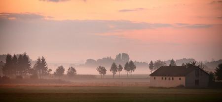 GREEN BUILDINGS: Autumn in Poland. Autumn foggy morning. September dawn in Poland