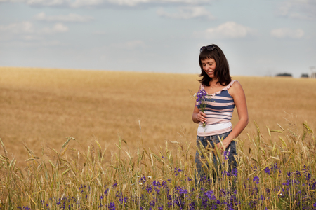 mid adult women: Mid Adult Women in a field with flowers Stock Photo