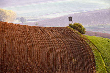 hunting: Arable lands in spring. Hunting box in Czech Moravia hills