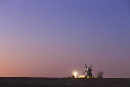 starry night: Old windmill in a starry spring night Stock Photo