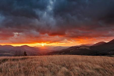 Autumn November cloudy sunrise in Carpathian mountains Stock Photo